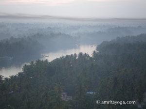Amritapuri ashram backwaters with mist