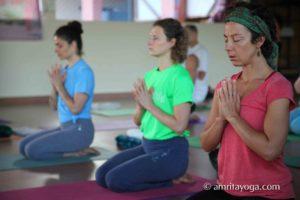 devotional pose during amrita yoga retreat