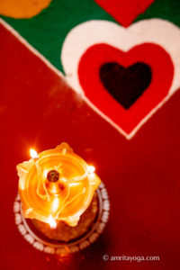 puja lamp with heart design
