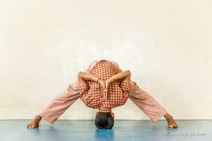 young person doing forward bend pose