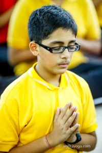 kolkata youth yellow shirt namaste pose