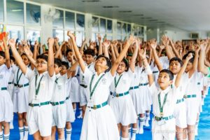 group of students raised hand