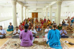 amrita yoga class seated namaste