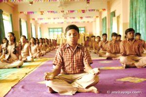young boy in padmasana meditation posture