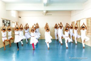 youngsters doing standing tree pose