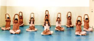 indian young people padmasana arms raised