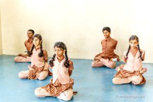 students seated padmasana upasana