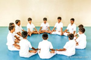 circle of young people meditating