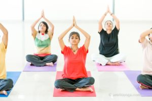 amrita yoga raised namaste pose
