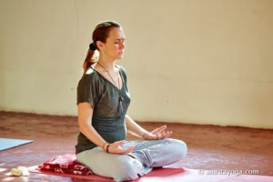 meditation posture with hands resting on thighs
