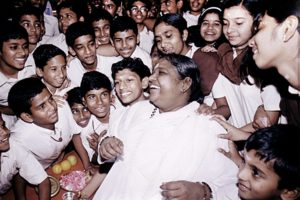 Amma laughing with children