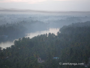 Amritapuri ashram backwaters with mist