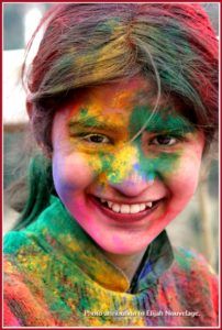 Holi Festival smile, photo by Elijah Nouvelage watermarked