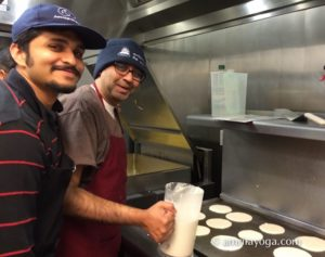 amma volunteers making pancakes