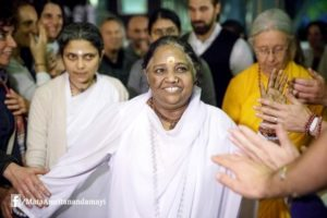 amma greeting devotees hands out