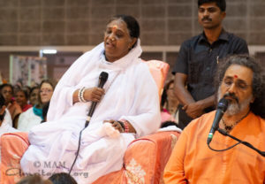 amma giving talk with Swami