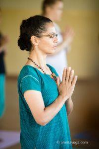 amrita yoga standing pose w namaste watermarked