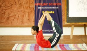 featured backbend yoga pose young person
