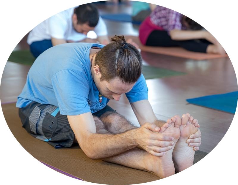 forward bend asana at amrita yoga program-circle crop