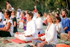 group meditation at amritapuri beach