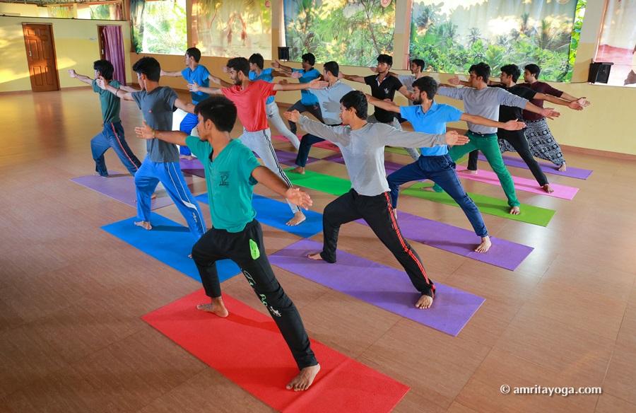 group warrior pose amrita yoga yoga shala watermarked