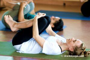 holding knees pose yoga