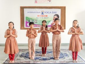 kids school uniforms standing namaste