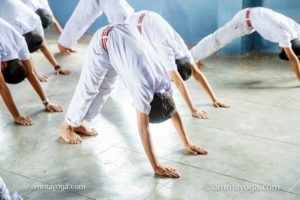 kids white clothes downward dog pose