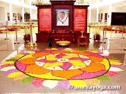 onam festival pookala flower design at Amrita