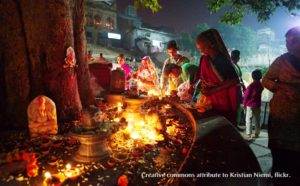 nightime shiva linga festival with oil lamps