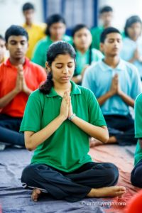 amrita yoga woman with green shirt
