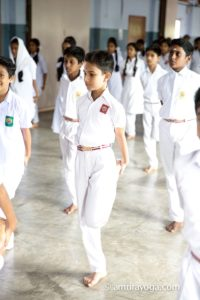 students standing pose white clothes
