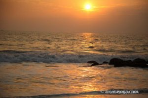 sunset at the beach at amritapuri ashram