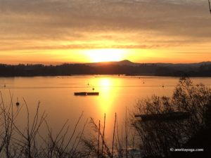 sunset over lake orange colors watermarked