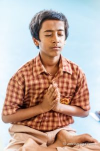 young man meditating padmasana